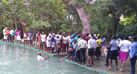 crowds watching baptisms